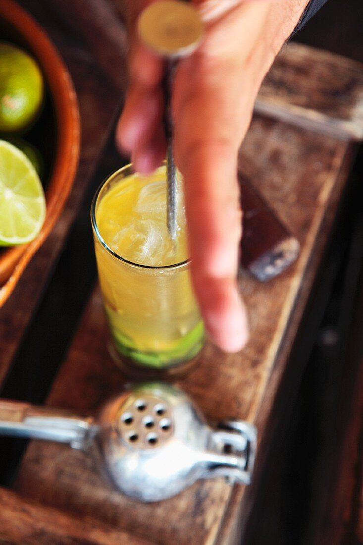A mojito being made (lime and ice being mixed)