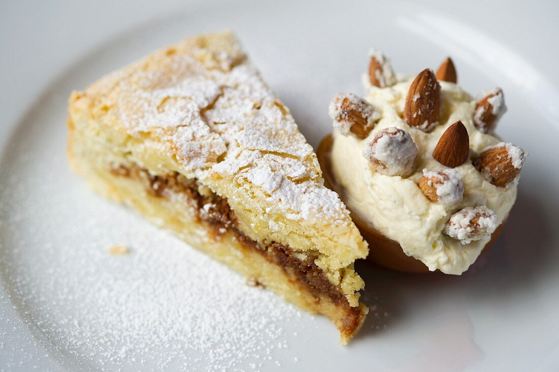 A slice of almond tart with almond ice cream