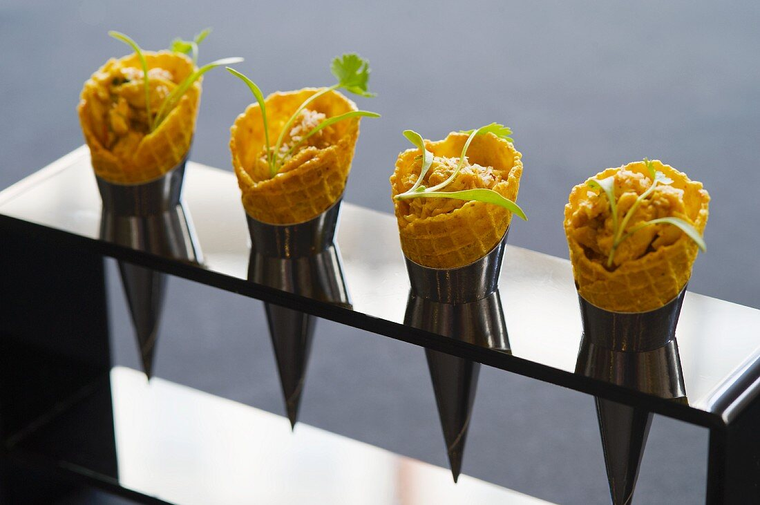 Ice cream cones filled with coronation chicken