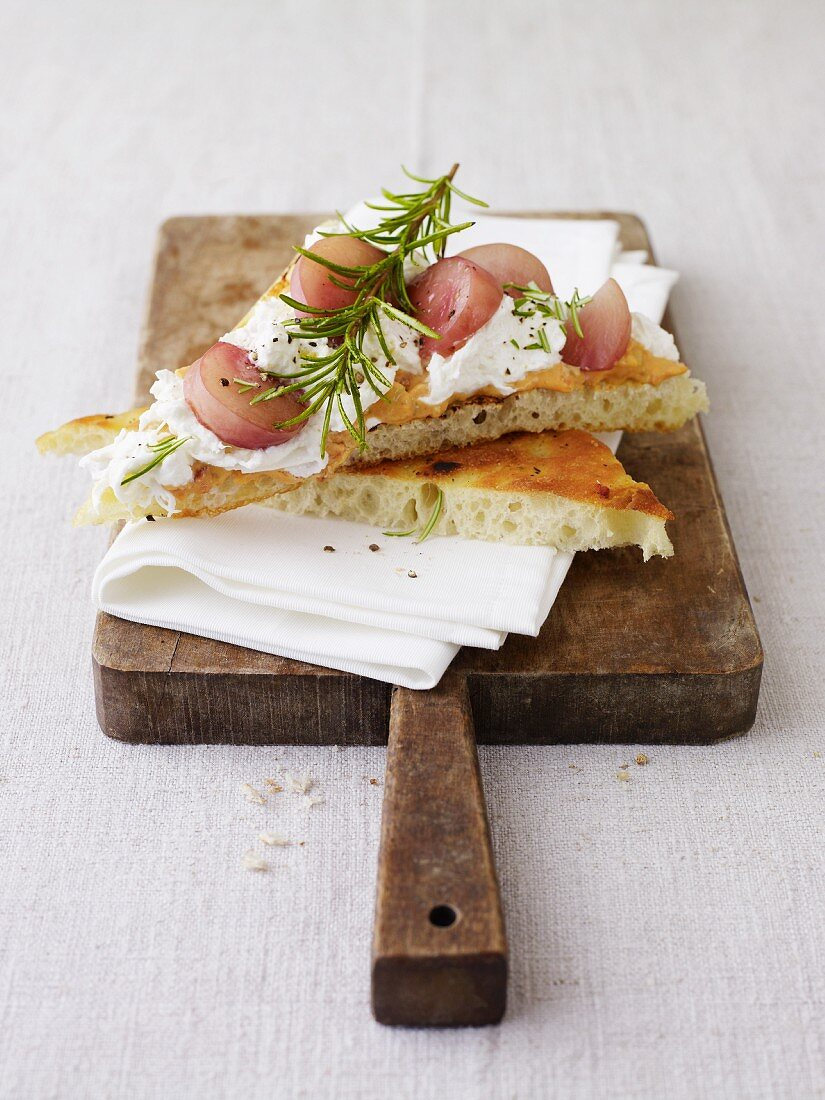 Focaccia corners topped with burrata and rosemary