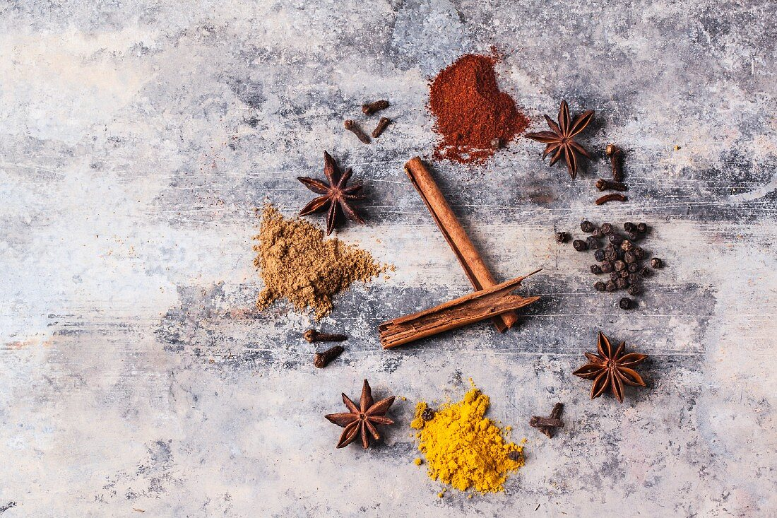 Various spices making the shape of a clock