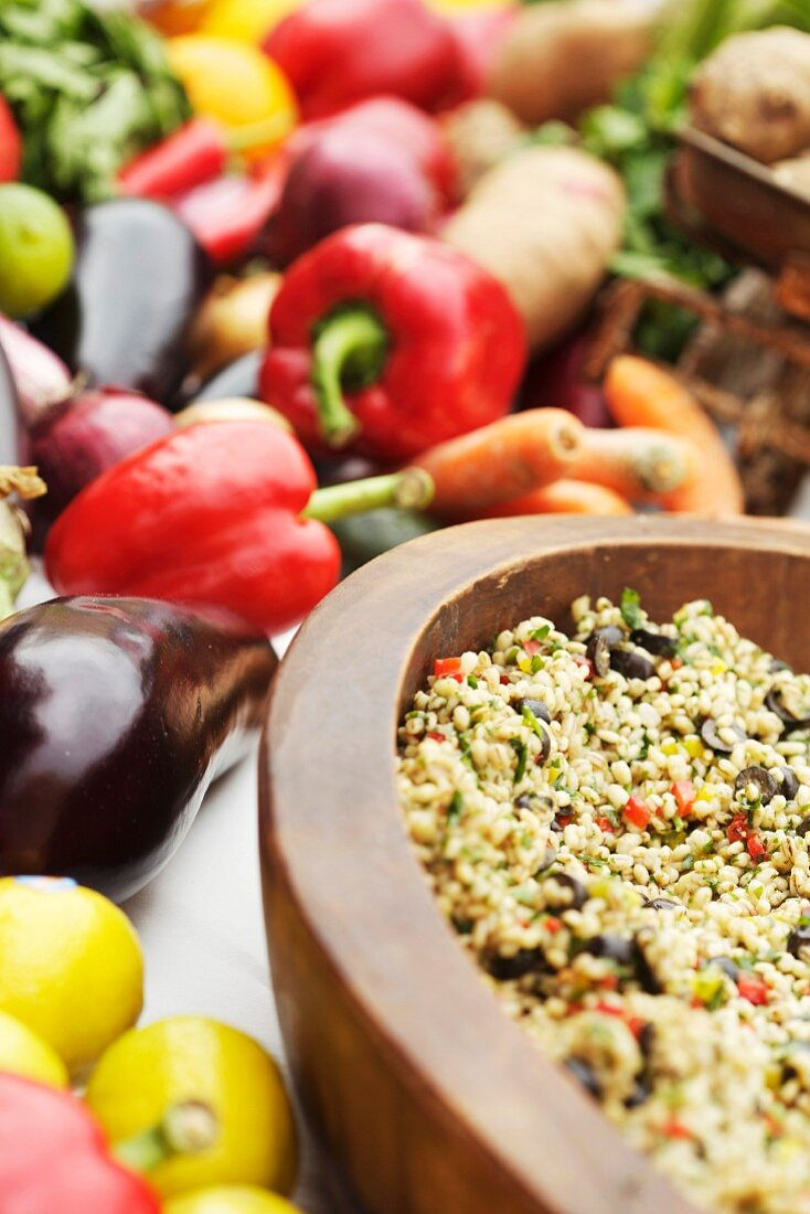 Fresh vegetables and a wooden bowl with buckwheat and vegetables