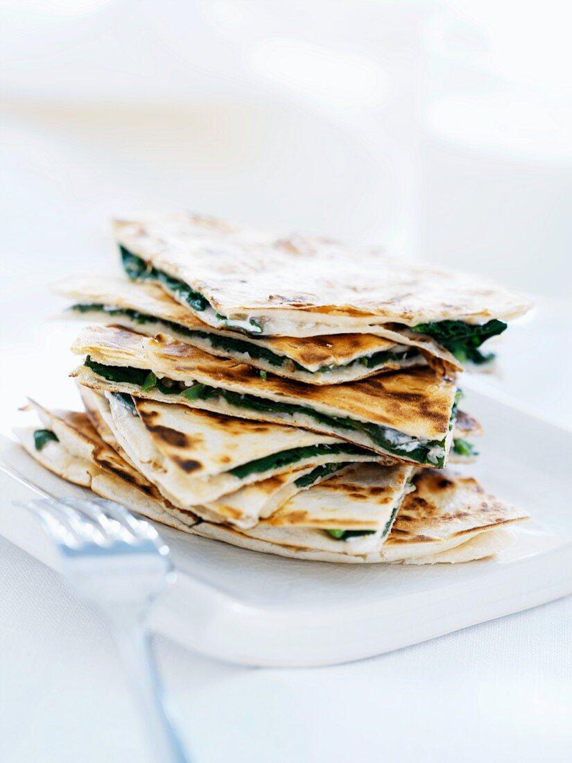 Piadina con gli spinaci (unleavened bread filled with spinach, Italy)