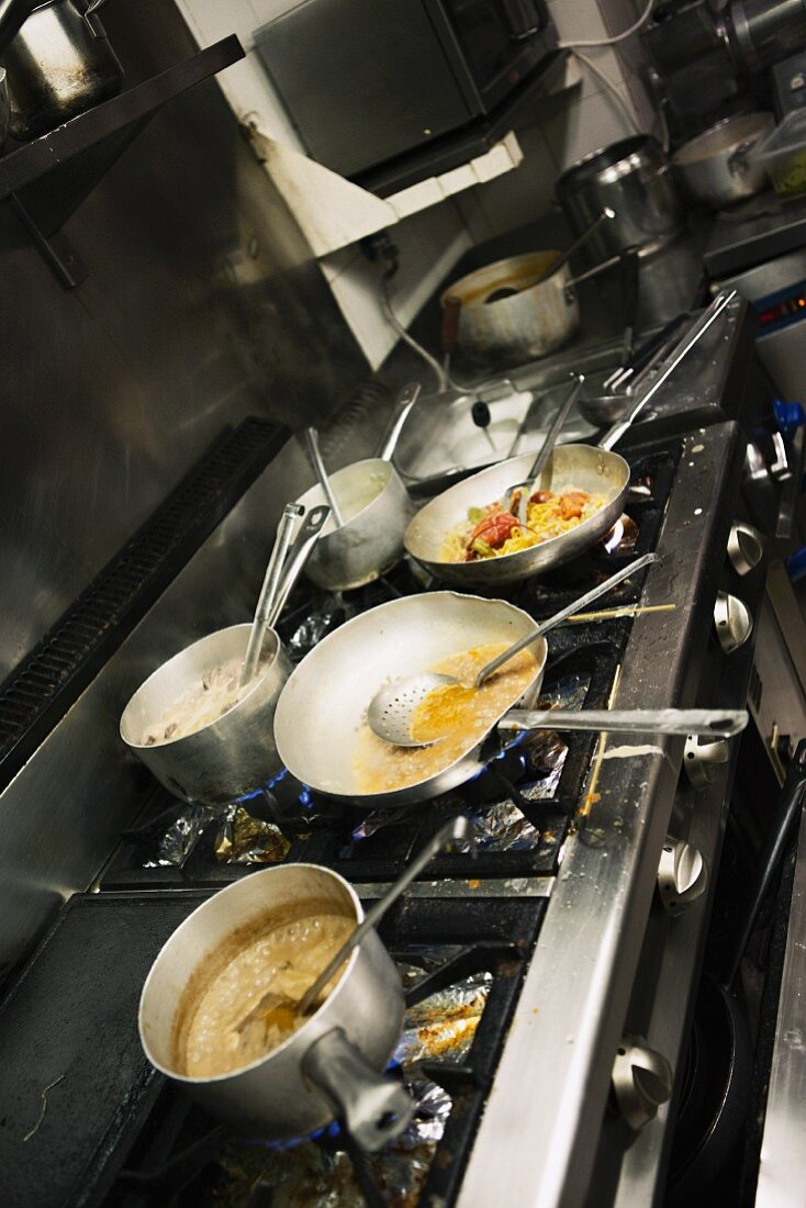 Food cooking on a stove in a restaurant