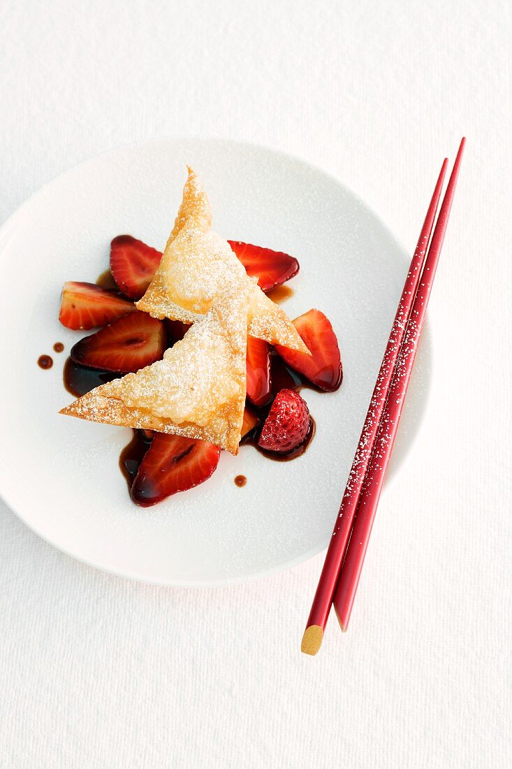 Won tons filled with mozzarella served on a bed of balsamic strawberries