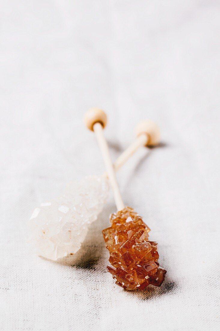 Sticks of white and brown rock sugar