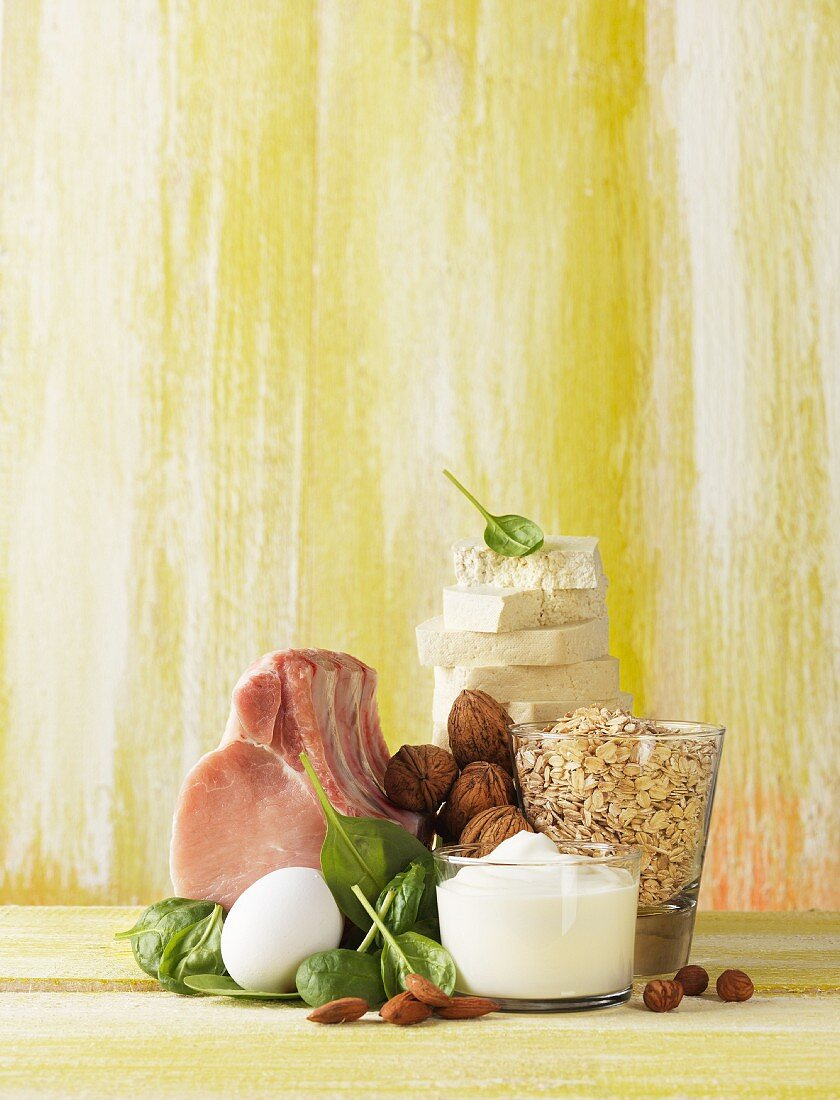 An arrangement featuring pork, an egg, spinach, nuts, dairy products and oats