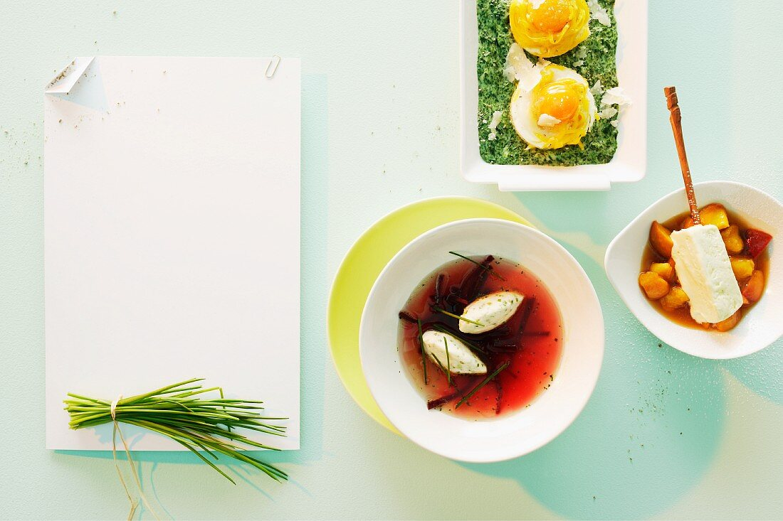 Vegetarian spring menu: chive and quark dumplings in beetroot broth, creamy spinach with egg in pasta nests, woodruff parfait with peach jelly