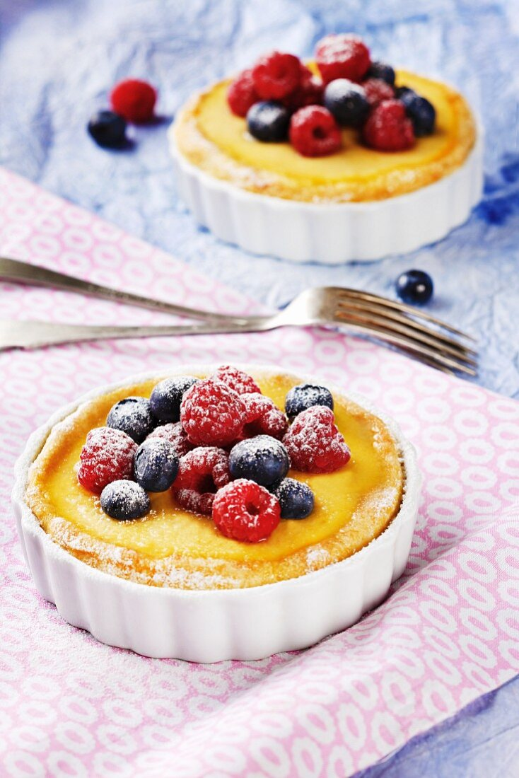 Vanilla tartlets topped with fresh berries