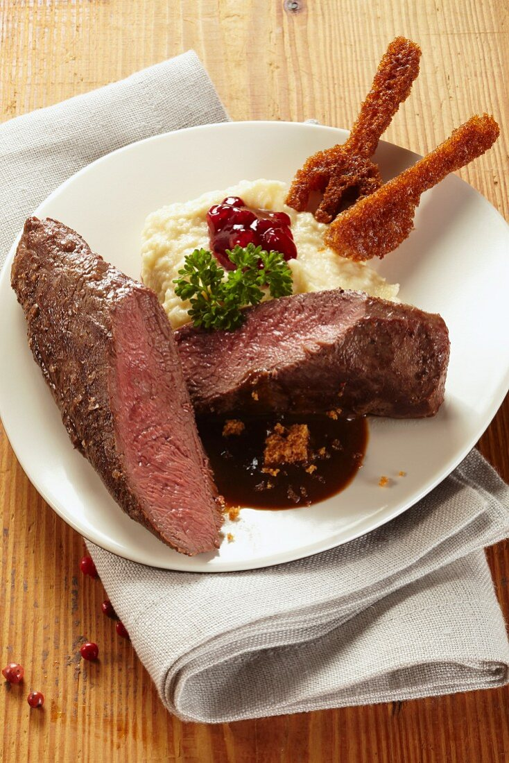 Saddle of hare with mashed celariac and cranberries