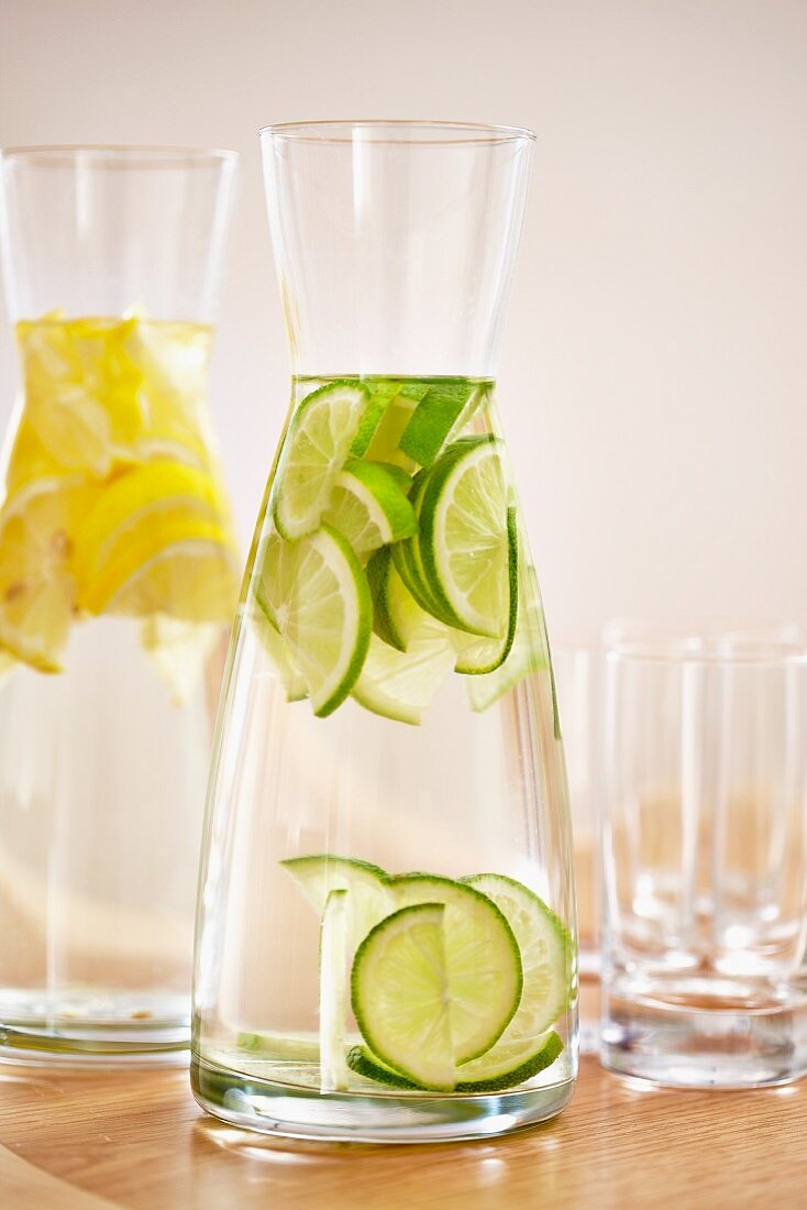Carafes of water with lemon and lime slices