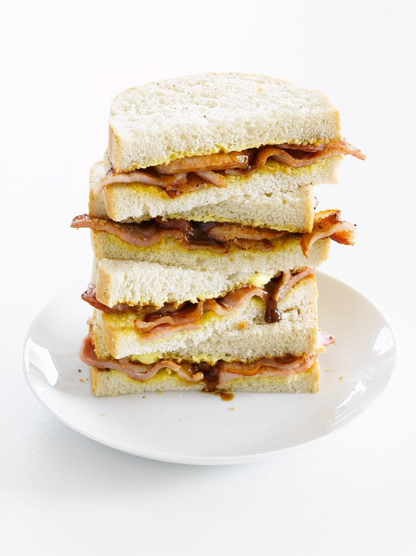 A stack of bacon and onion sandwiches