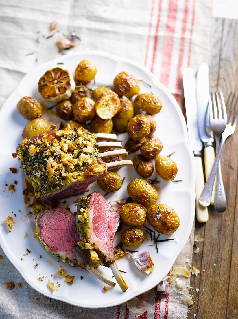 Lamb loin rack joint with a herb crust and rosemary potatoes