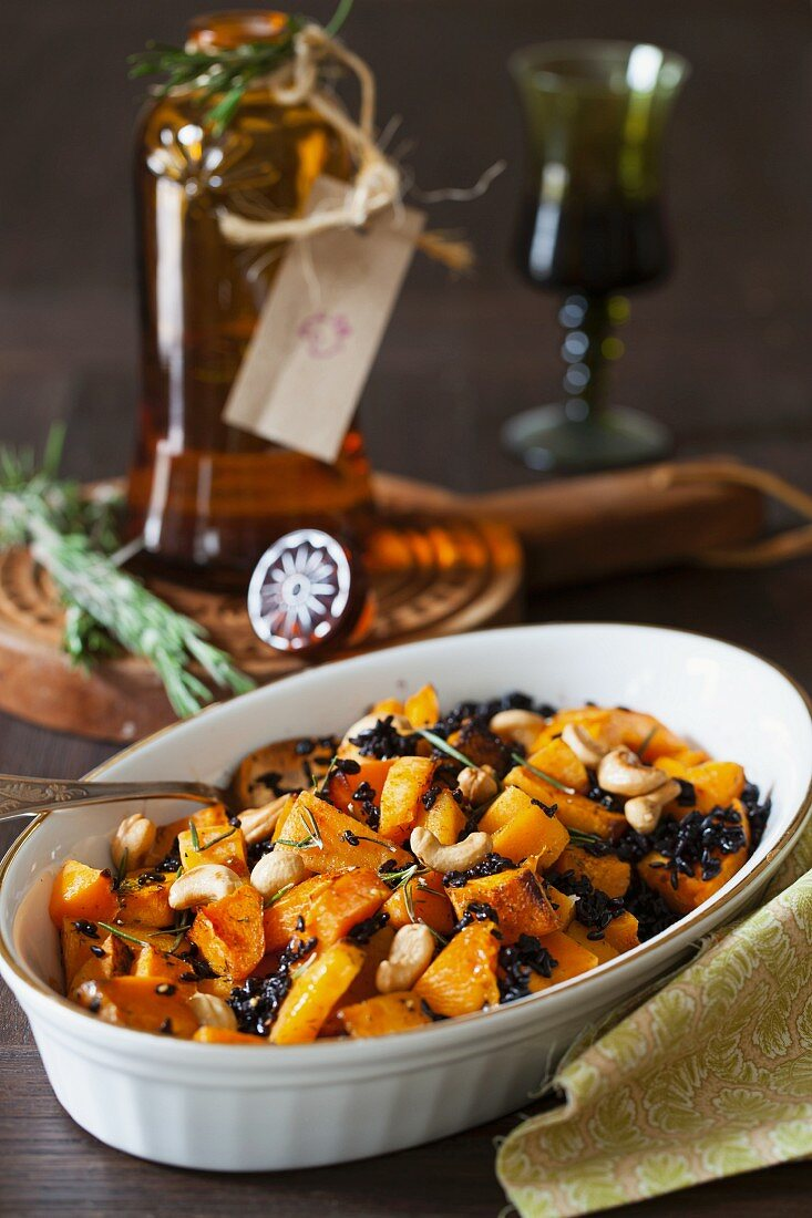Roasted pumpkin with rosemary, black rice and cashew nuts