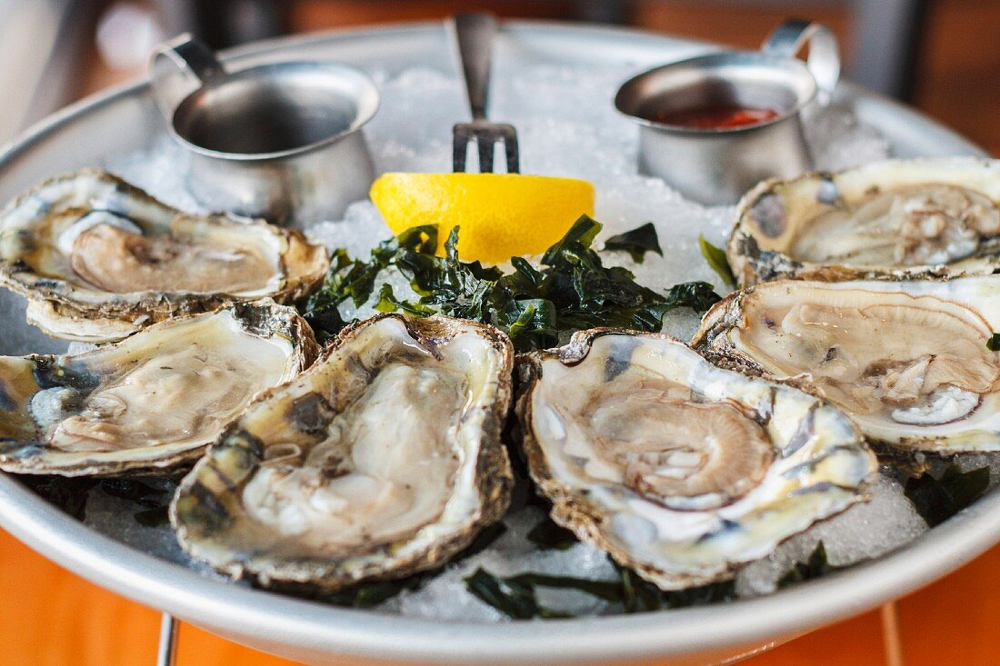 Raw oysters with seaweed and lemon