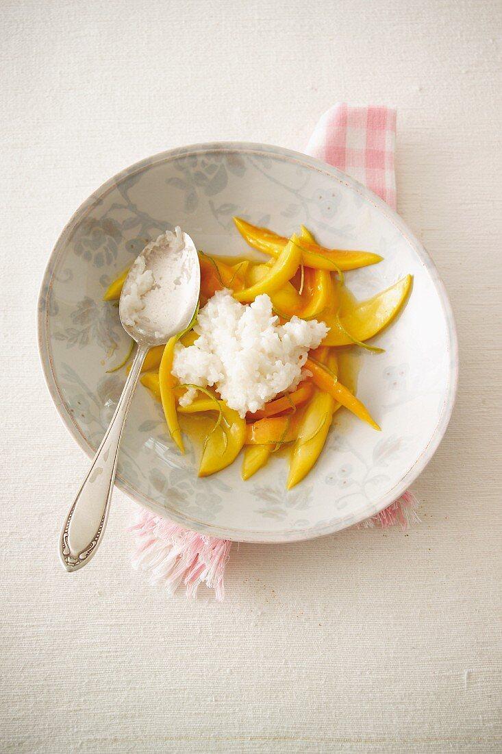 Mango and papaya with coconut rice puidding
