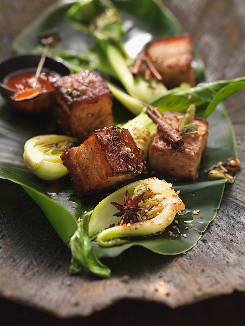 Roast pork Saigon with bok choy and banana leaves