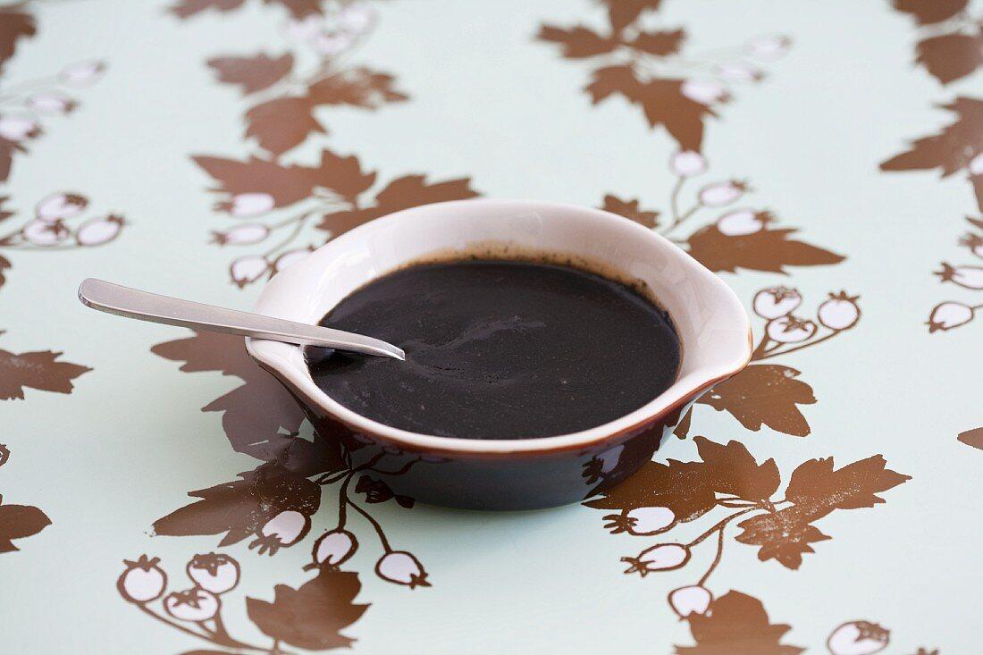 Sugar beet syrup in a brown bowl