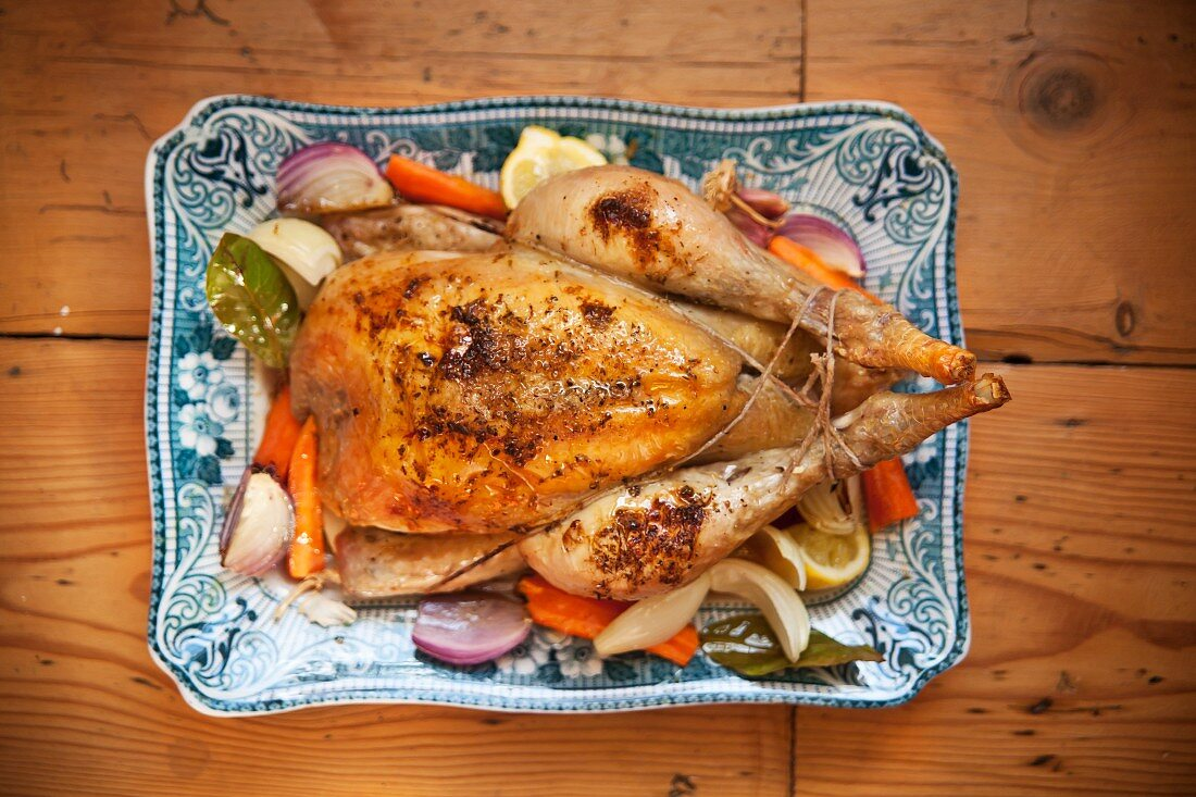 Roast chicken with root vegetables on a serving platter