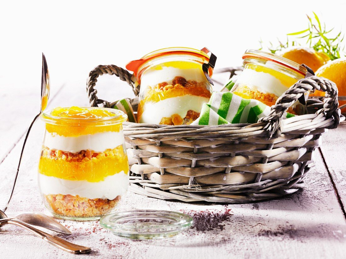 Orange cheesecake in jars for a picnic