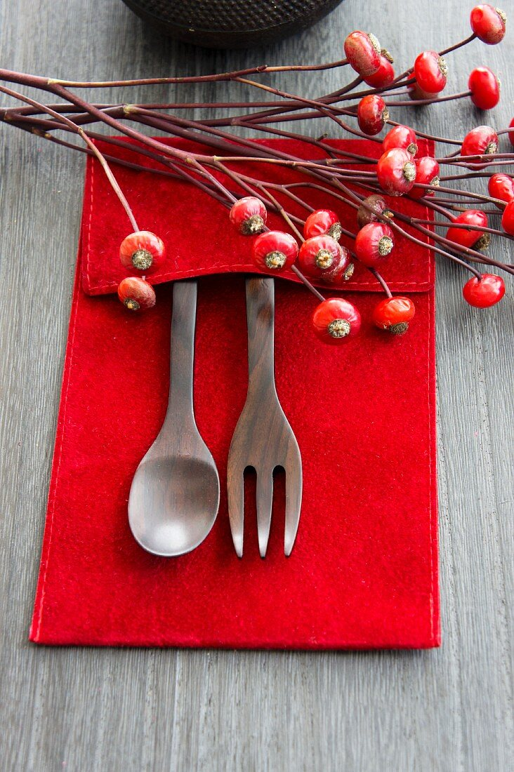 Wooden cutlery and rosehips