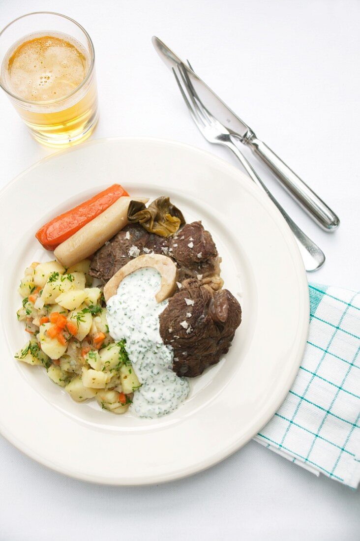 Boiled beef with boulangère potatoes and a chive sauce