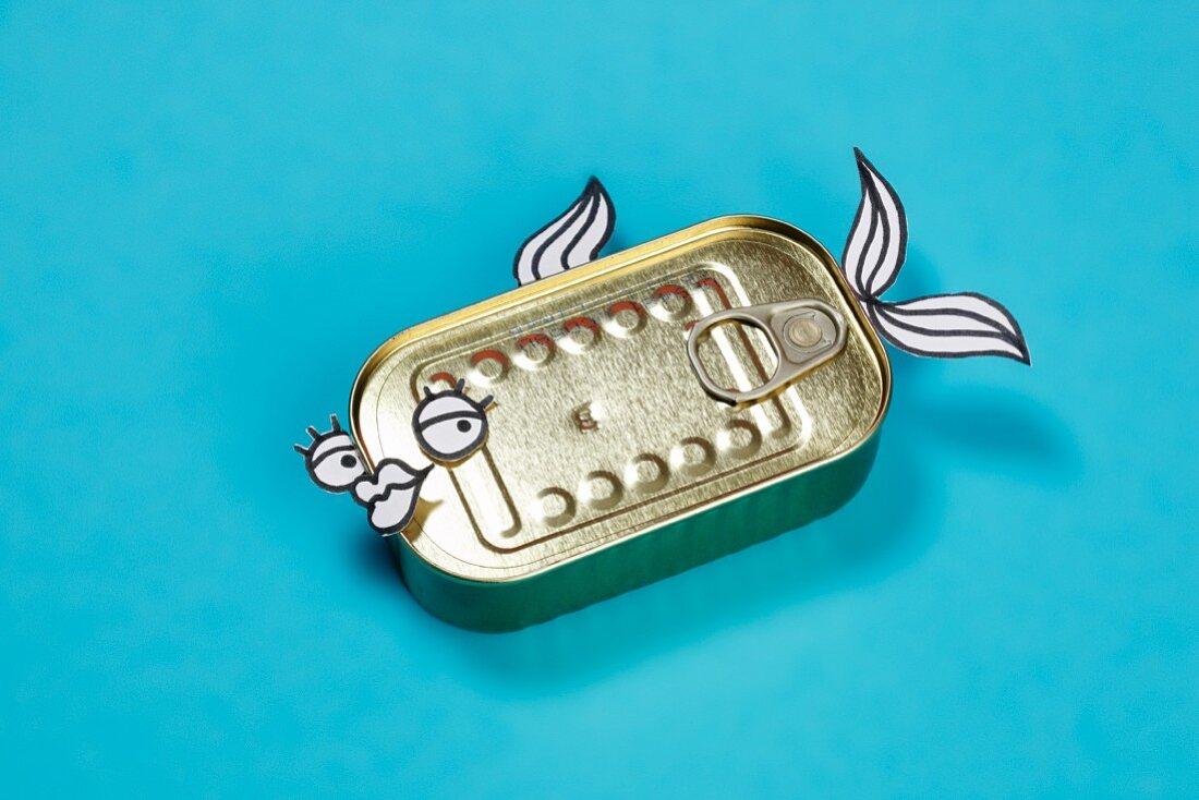 A tin of sardines with a face