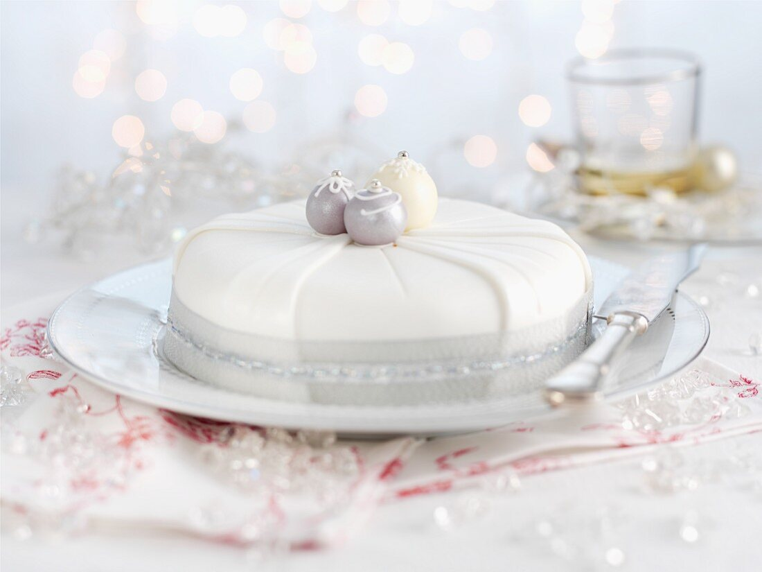 A silver-and-white fruit cake