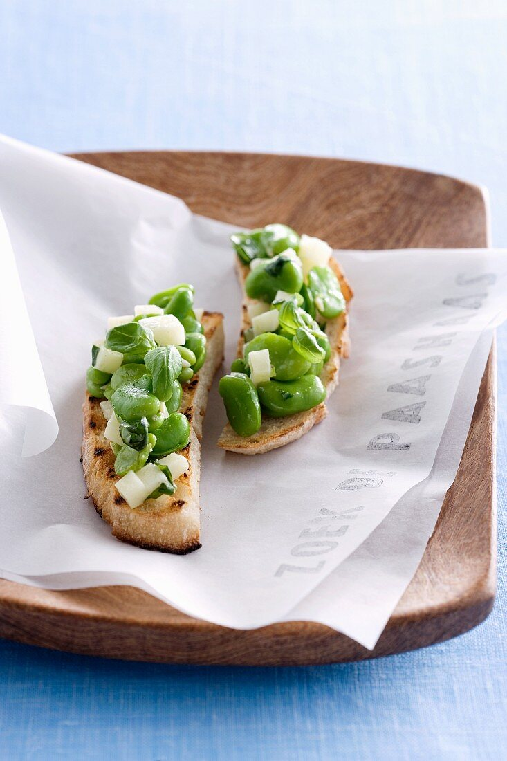 Toasted bread topped with a bean salad