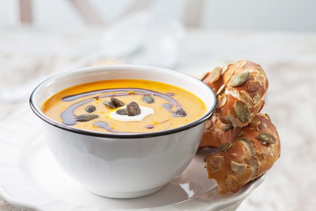Pumpkin soup with creme fraiche, pumpkin seed oil and pumpkin seeds