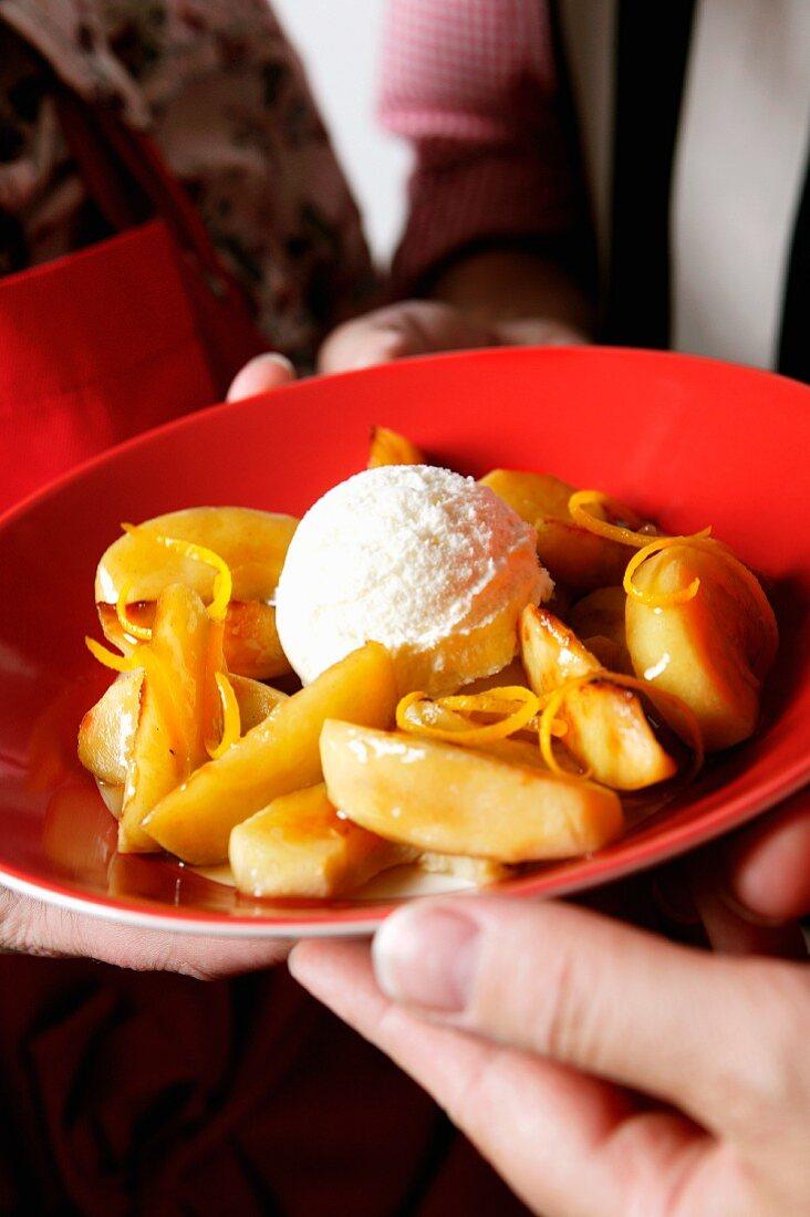 Orange and apple compote with vanilla ice cream