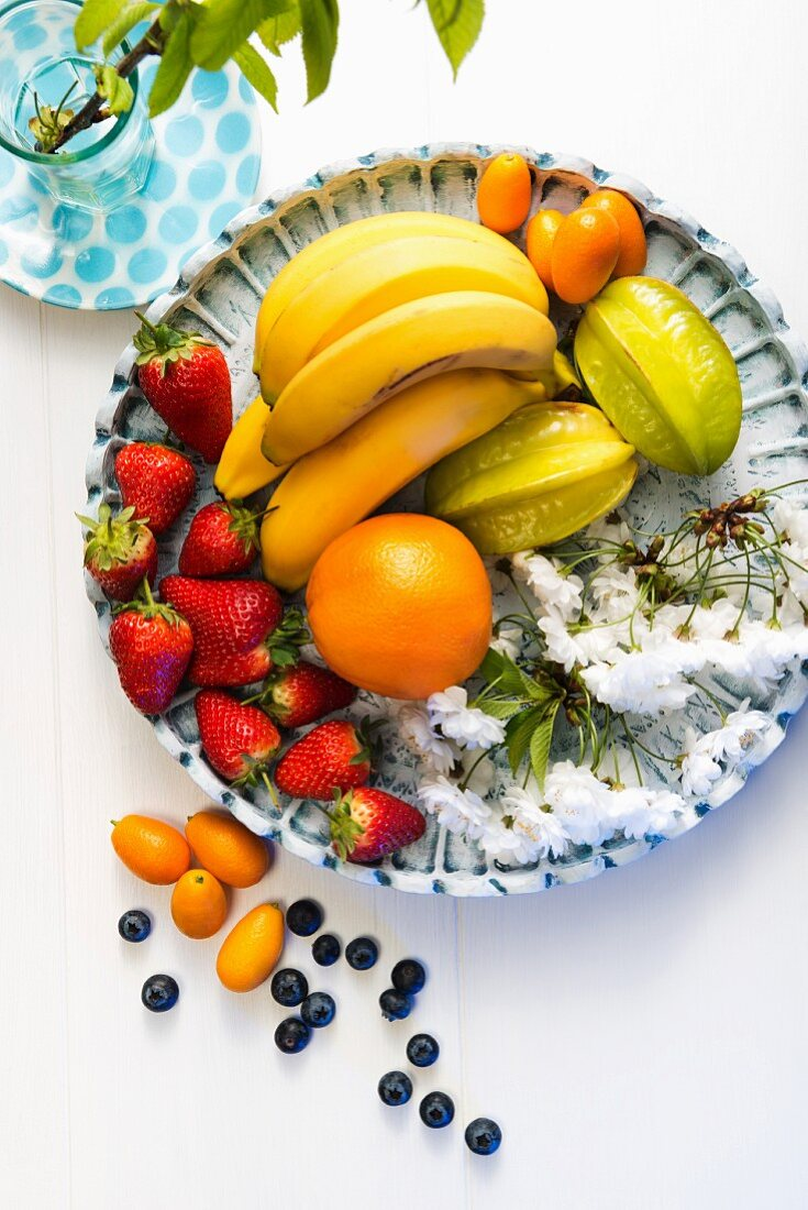 A fruit platter with cherry blossoms