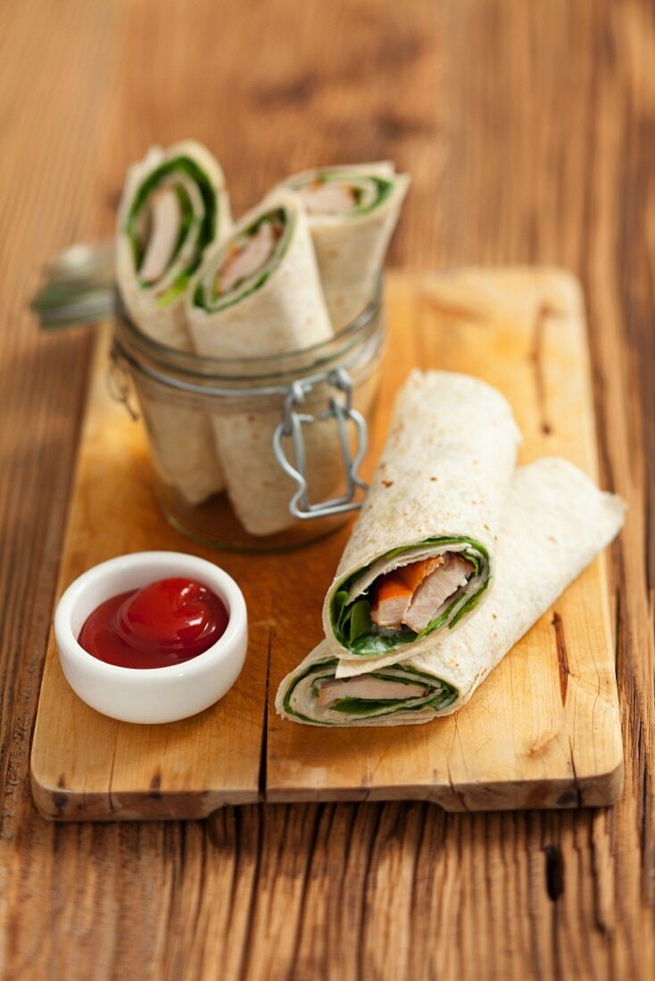 Tortilla wraps with spinach and smoked chicken breast