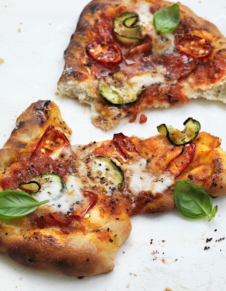 Pizza topped with courgette and dried tomatoes