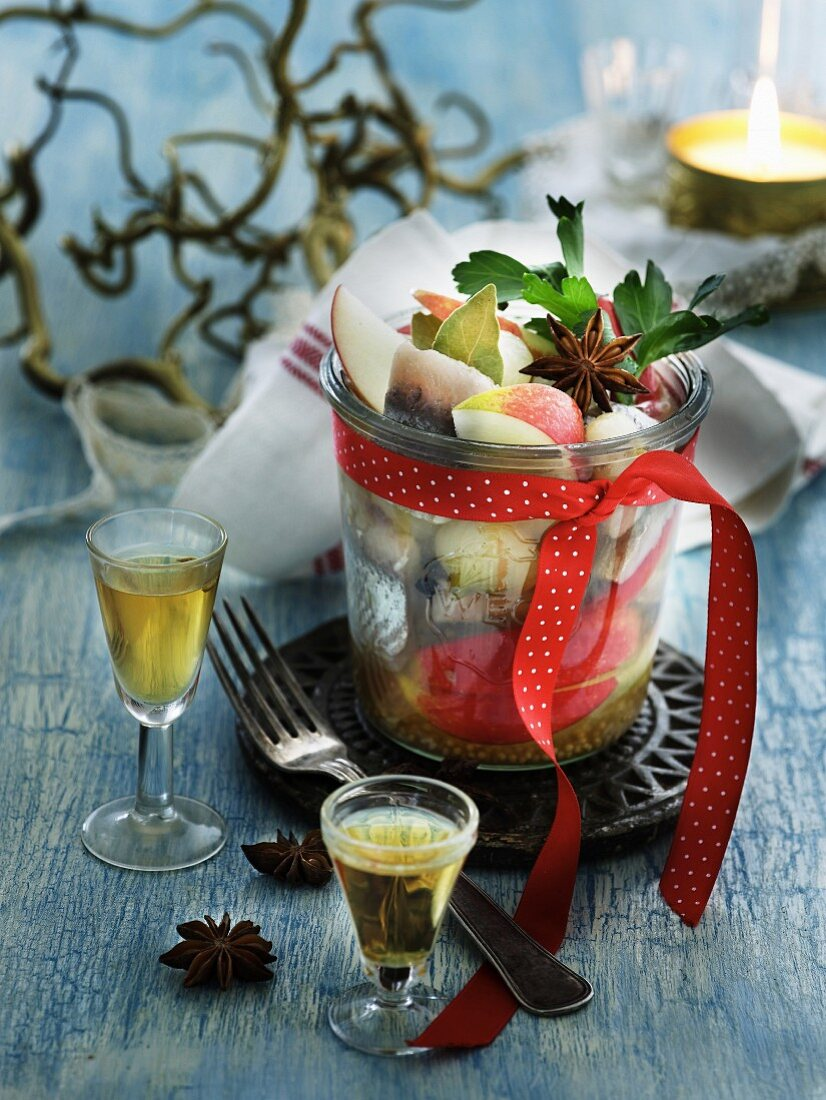 Pickled herring with apple and star anise served with aquavit