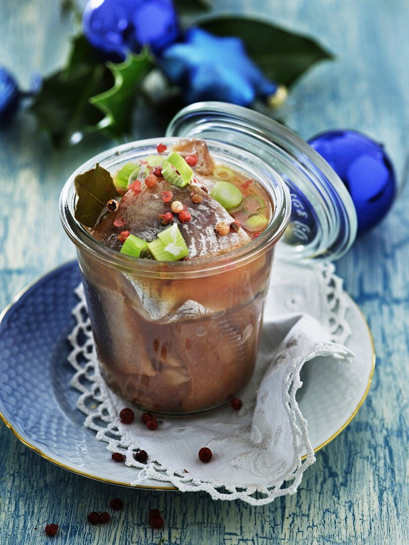 Sour pickled herring with herbs and spices