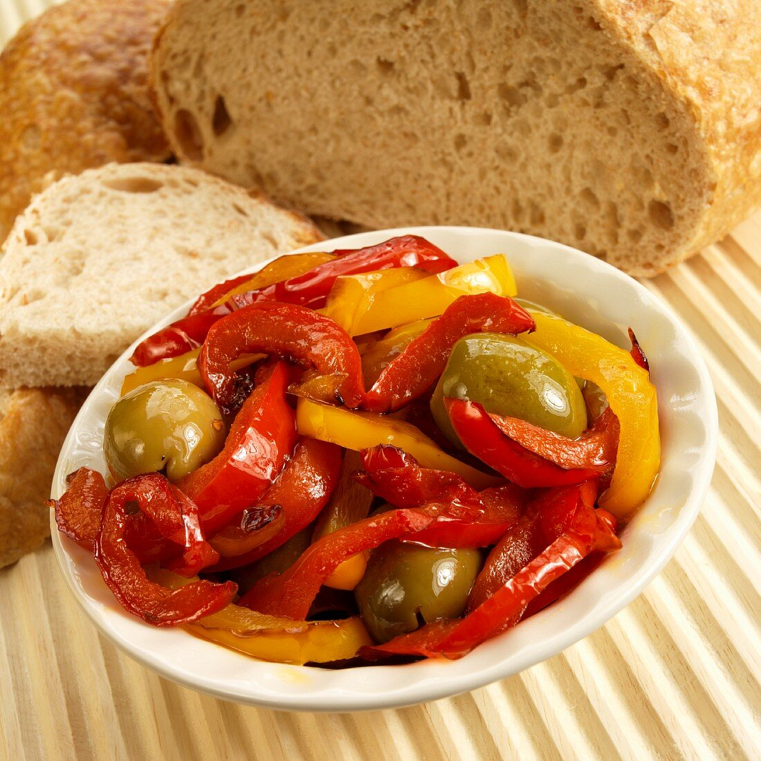 Peperonata (red and yellow peppers, green olives, garlic) with bread