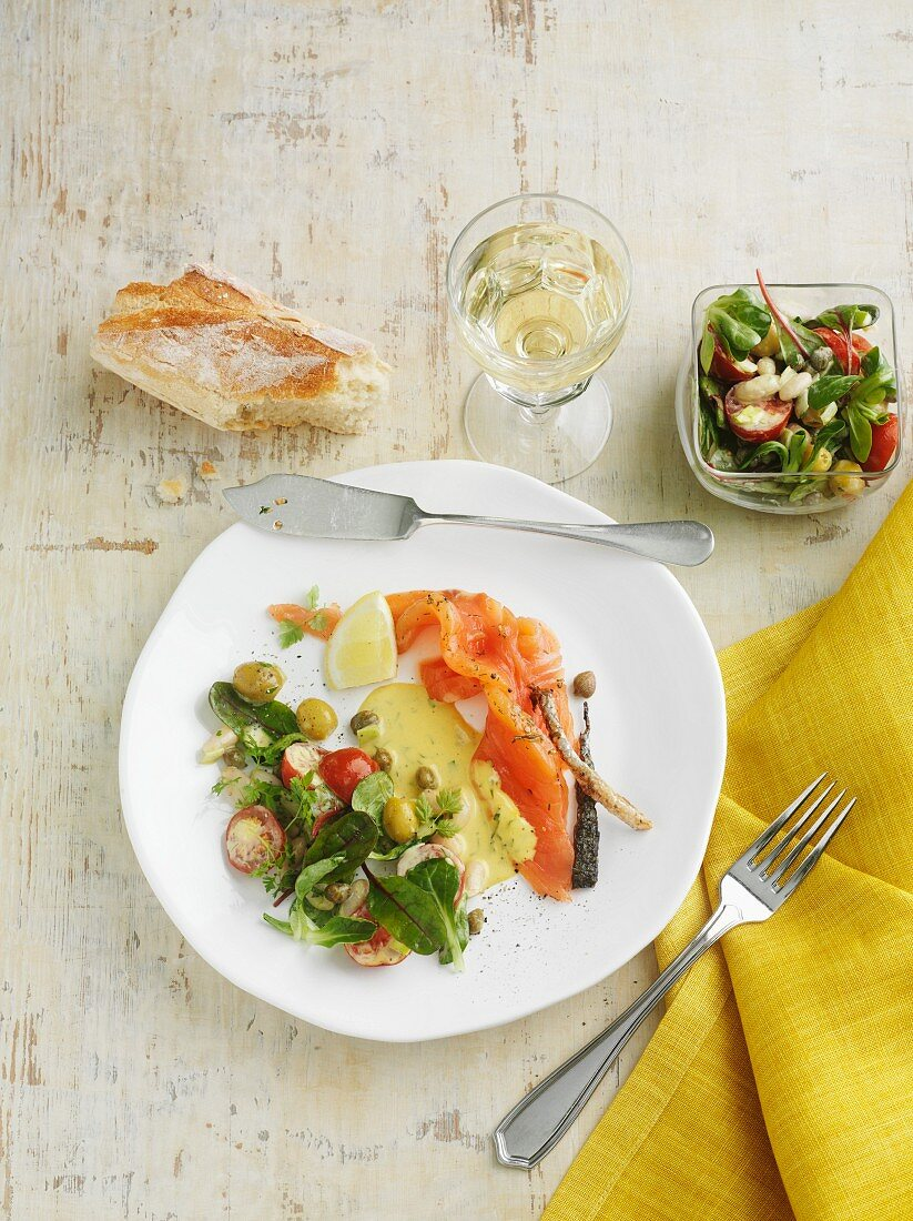 Smoked salmon with a mustard sauce and a side salad