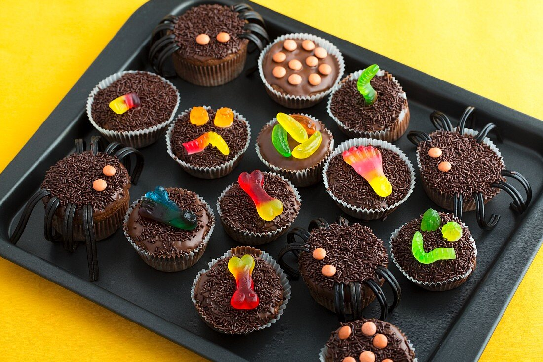 Various chocolate cupcakes decorated with sweets for Halloween