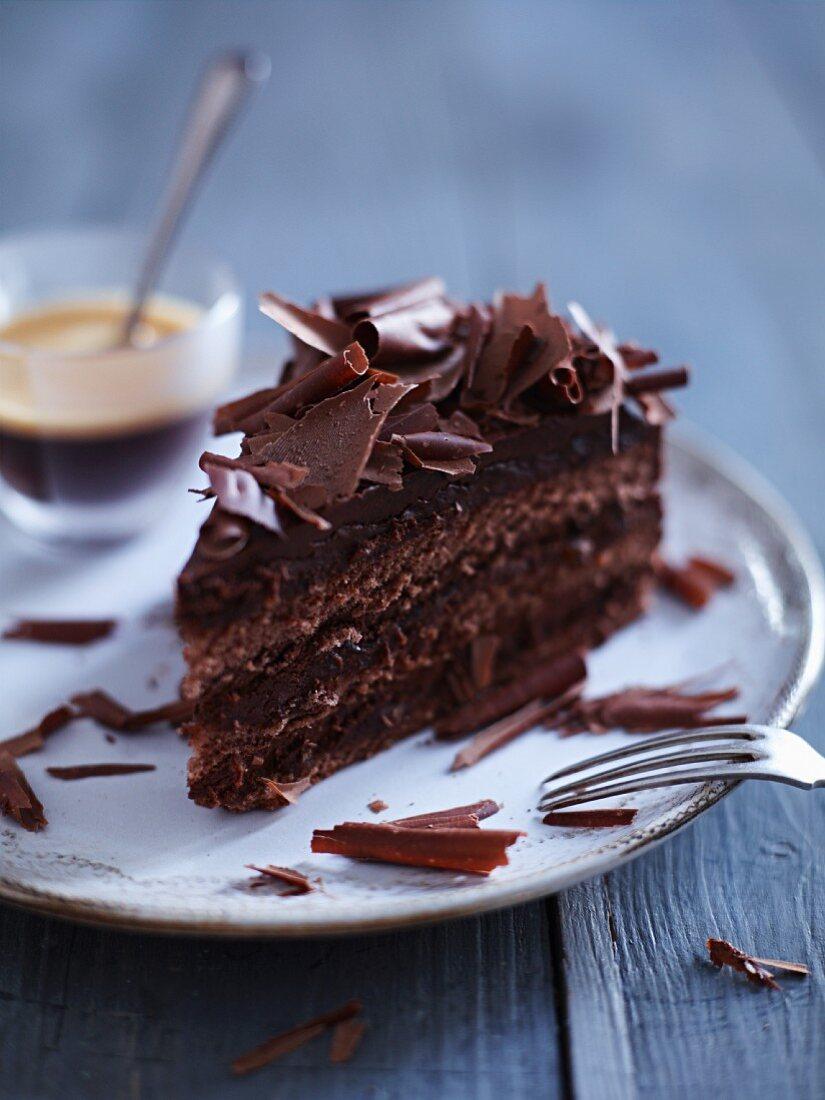 Dark chocolate cream cake with chocolate curls