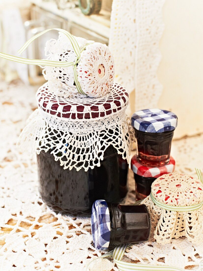 Jars of blackberry jam with lace covers