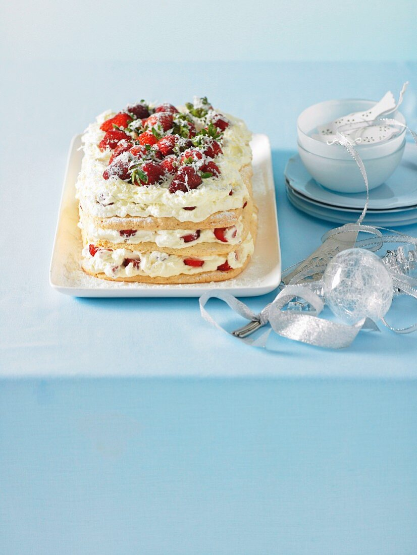White chocolate meringue cake with strawberries for Christmas