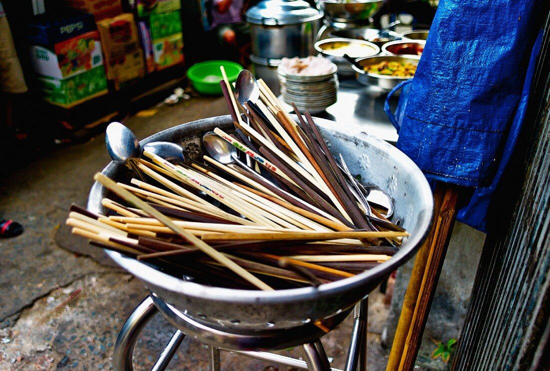 A bowl of chopsticks at a street bar in Saigon (Vietnam)
