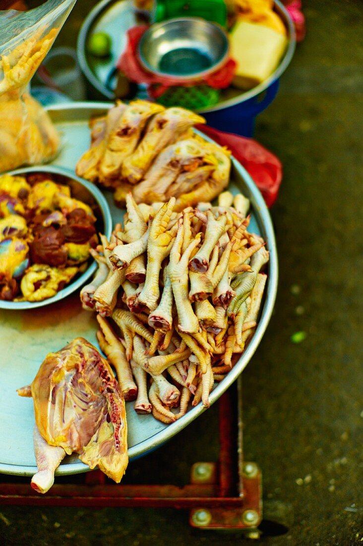 Various chicken bits at a market in Saigon (Vietnam)
