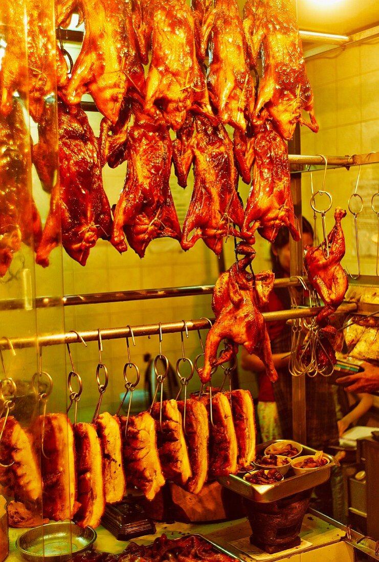 Poultry, pork and suckling pigs at a butchers (Saigon, Vietnam)