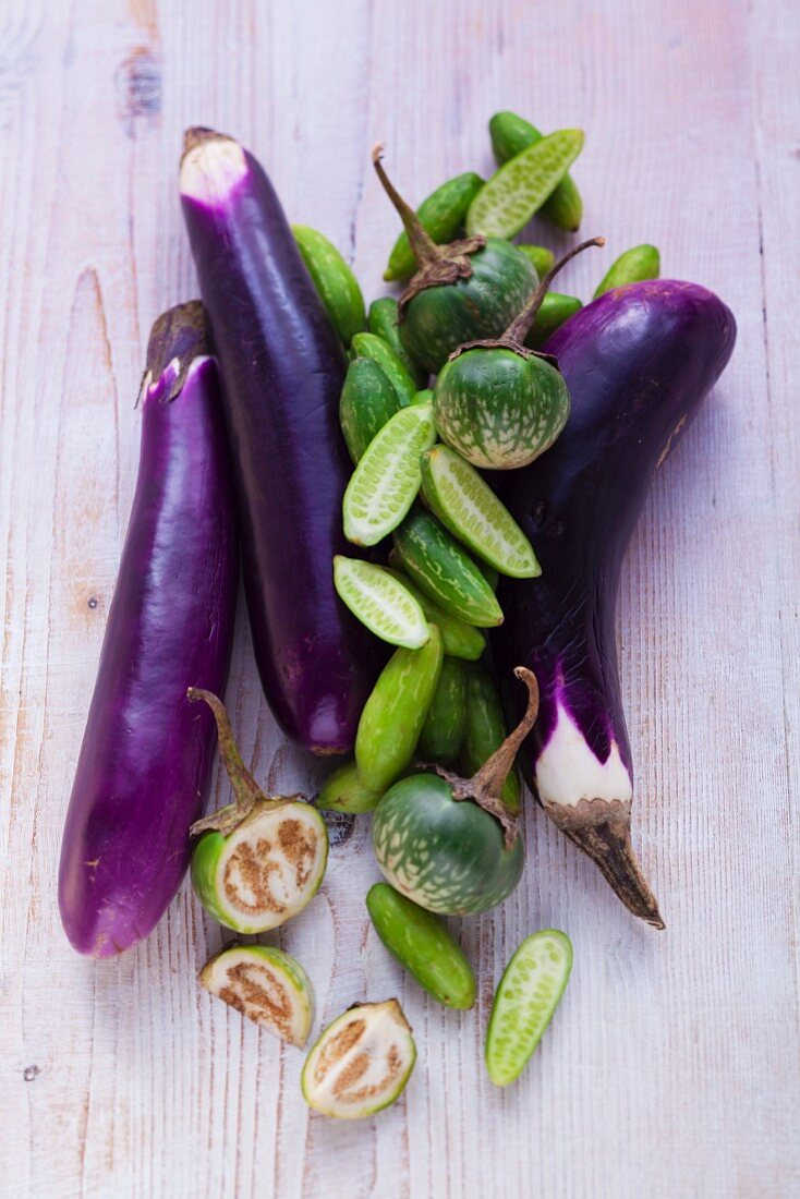 An arrangement of aubergines and cucumbers