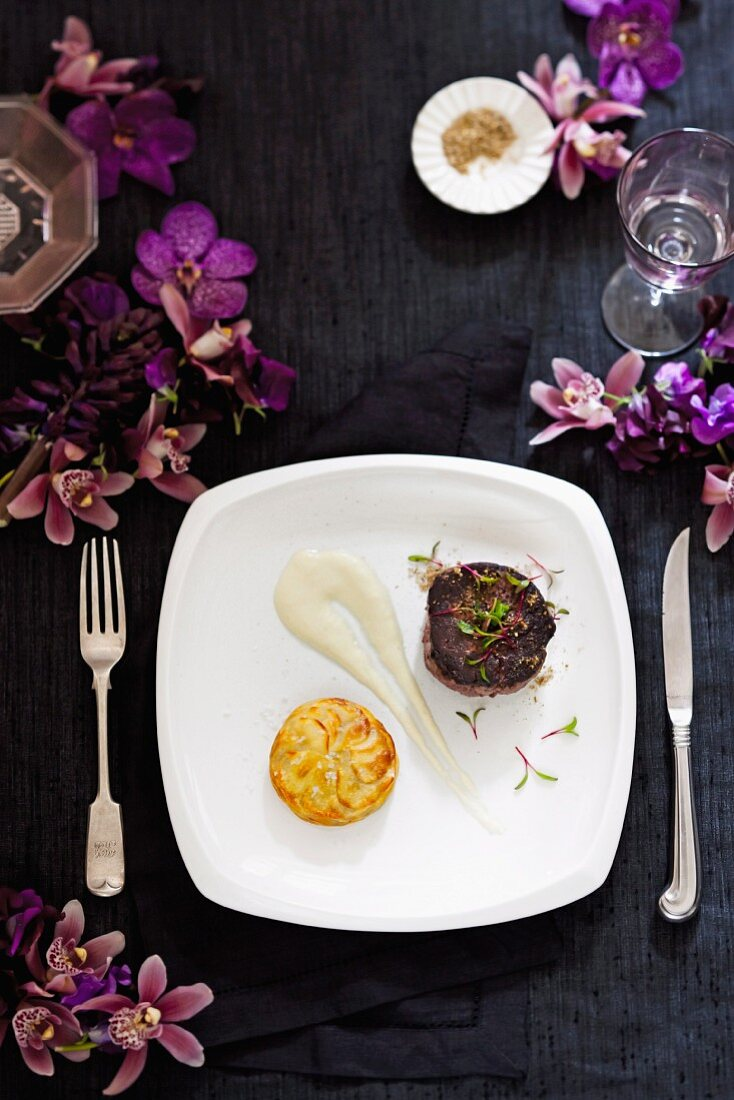 Wagyu beef fillet with potato galette and cauliflower and onion soubise