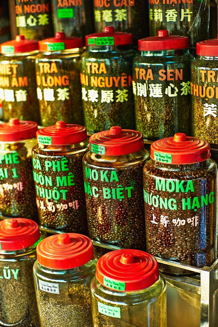 Various types of tea and coffee in jars at a market in Saigon (Vietnam)