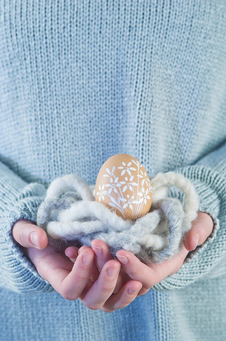 An Easter egg in a wool nest