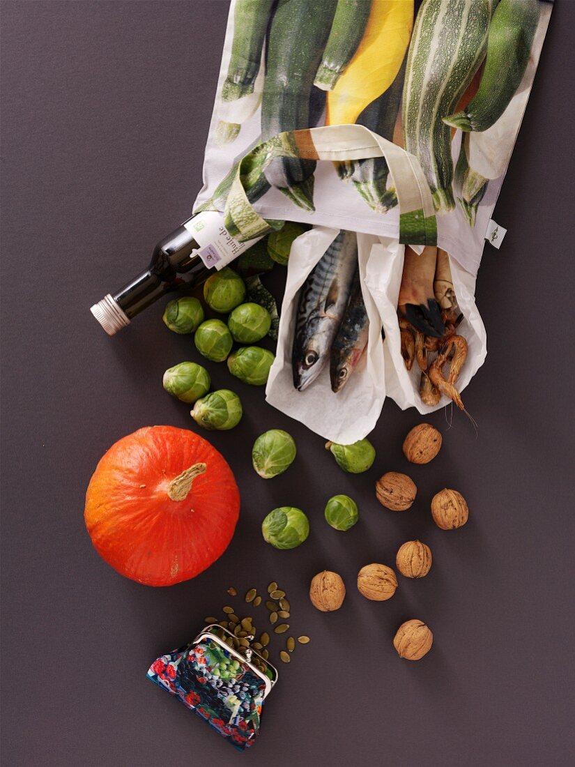 Healthy food with omega 3 fatty acids falling from a shopping bag
